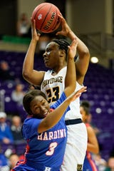 Harding Academy guard Jacaila Davis fouls PCA center Yaubryon Chambers (23) during the first half of their semifinal game in the TSSAA State Basketball Championships at Allen Arena Friday, March 1, 2019 in Nashville, Tenn.