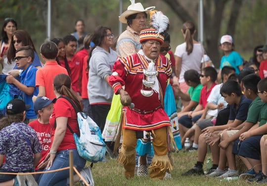 Seminole Tribal elder Bobby Henry leads a Seminole friendship dance at the Seminole Shootout Battle Reenactment at the John Jimmie Memorial Arena in Immokalee on Friday 3/1/2019. The event runs through Sunday and offers battles, dances, alligator wrestling, music and more.