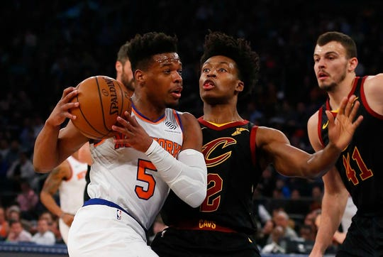 Cleveland Cavaliers guard Collin Sexton (2) defends against New York Knicks guard Dennis Smith Jr. (5) during the first half at Madison Square Garden.