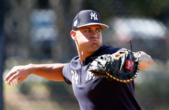 New York Yankees catcher Gary Sanchez (24) throws to second base during spring training workouts at George M. Steinbrenner Field. The slugging catcher is due to make his 2019 Grapefruit League debut on Friday night, when the Yankees host the Orioles.
