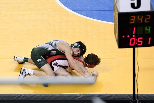 Nicholas Nardone of Delbarton looks to the clock during his 113-pound bout against Quinn Melofchick of Belvidere on Day 2 of the NJSIAA state wrestling tournament on Friday, March 1, 2019, in Atlantic City.
