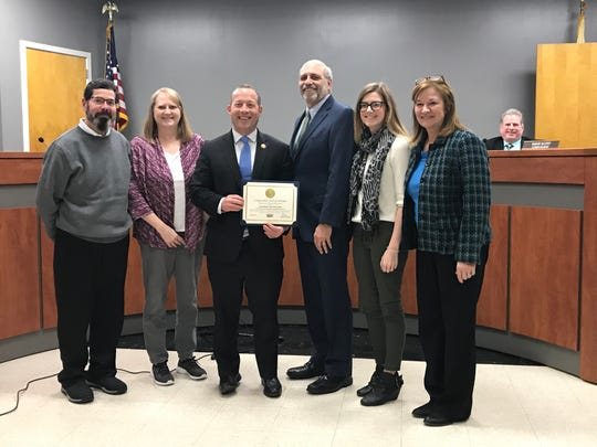 January 7, 2019: Norwood Borough Councilman Thomas Brizzolara (center right) stands with Congressman Josh Gottheimer (center left) and his family at the borough's reorganization meeting.