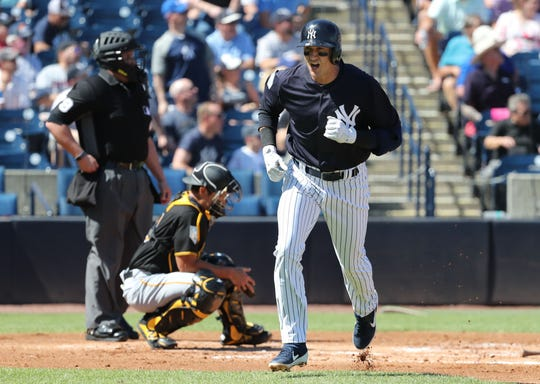 Feb 28, 2019; Tampa, FL, USA;New York Yankees shortstop Troy Tulowitzki (12) reacts as he hits a 3-run home run during the first inning against the Pittsburgh Pirates at George M. Steinbrenner Field.