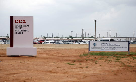 In this June 30, 2015, file photo, signs are seen at the entrance to the South Texas Family Residential Center in Dilley, Texas. The mother of a migrant toddler who died shortly after being released from the nation's largest family detention center on Thursday, Feb. 28, 2019, sued the tiny Arizona city that for years was paid by the U.S. government to run the facility in name only. Yazmin Juarez's lawsuit alleges that her 1-year-old daughter, Mariee, developed a respiratory illness at the South Texas Family Residential Center in Dilley, Texas, and medical staff did not adequately treat her before releasing them three weeks later. (AP Photo/Eric Gay, File)