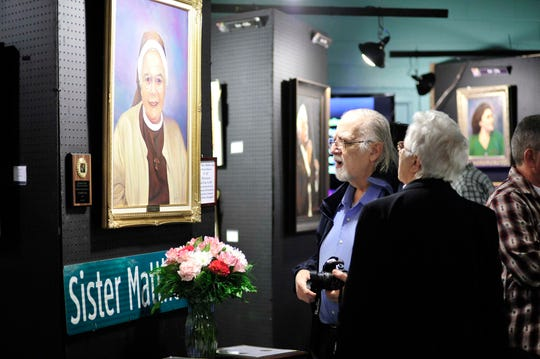 The late Sister Matthew Cola, Grace Catherine Cola, who helped organize the art show, was the subject of a painting that sold for $1,500 at the 17th Annual Art, Photography & Poetry Exhibition and Sale at St. Catherine of Bologna Parish Center in March 2016.