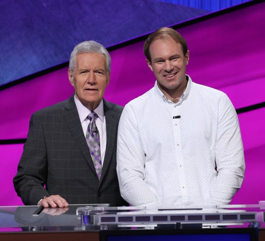 "Host Alex Trebek joins ""Jeopardy!"" player David Madden at the All-Star Games."