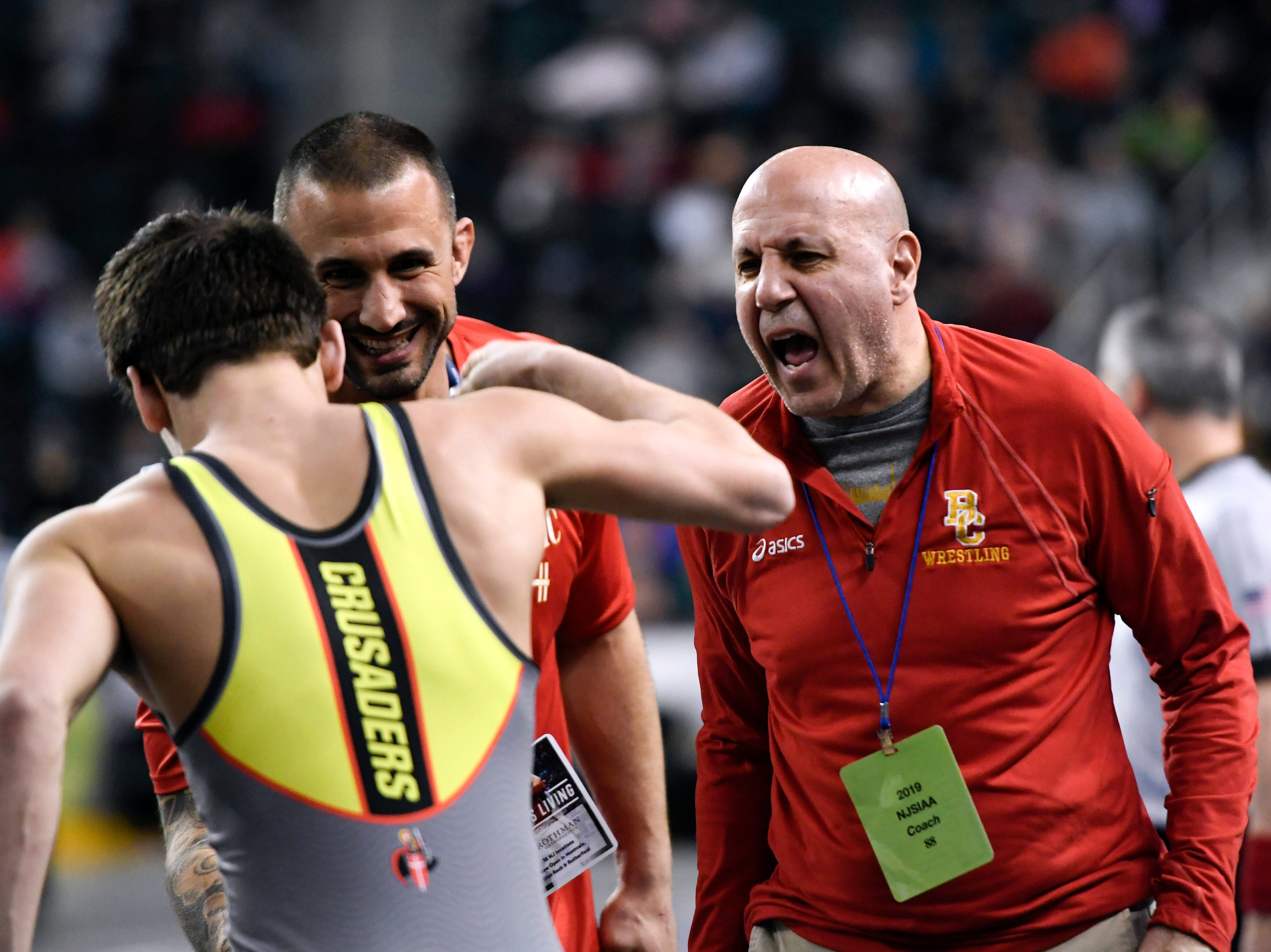 Bergen Catholic head coach David Bell celebrates with Alex Strashinsky and assistant coach Dom Santoli after Strashinsky wins his 138-pound match on Day 2 of the NJSIAA state wrestling tournament on Friday, March 1, 2019, in Atlantic City.