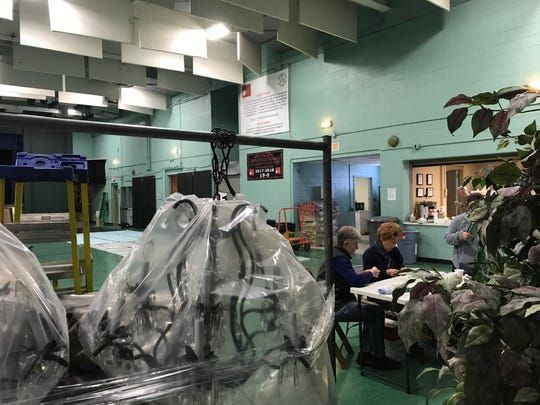 Volunteers help transform St. Catherine of Bologna's parish center in Ringwood transform into an art gallery for a March 8-10 show on March 1, 2019.