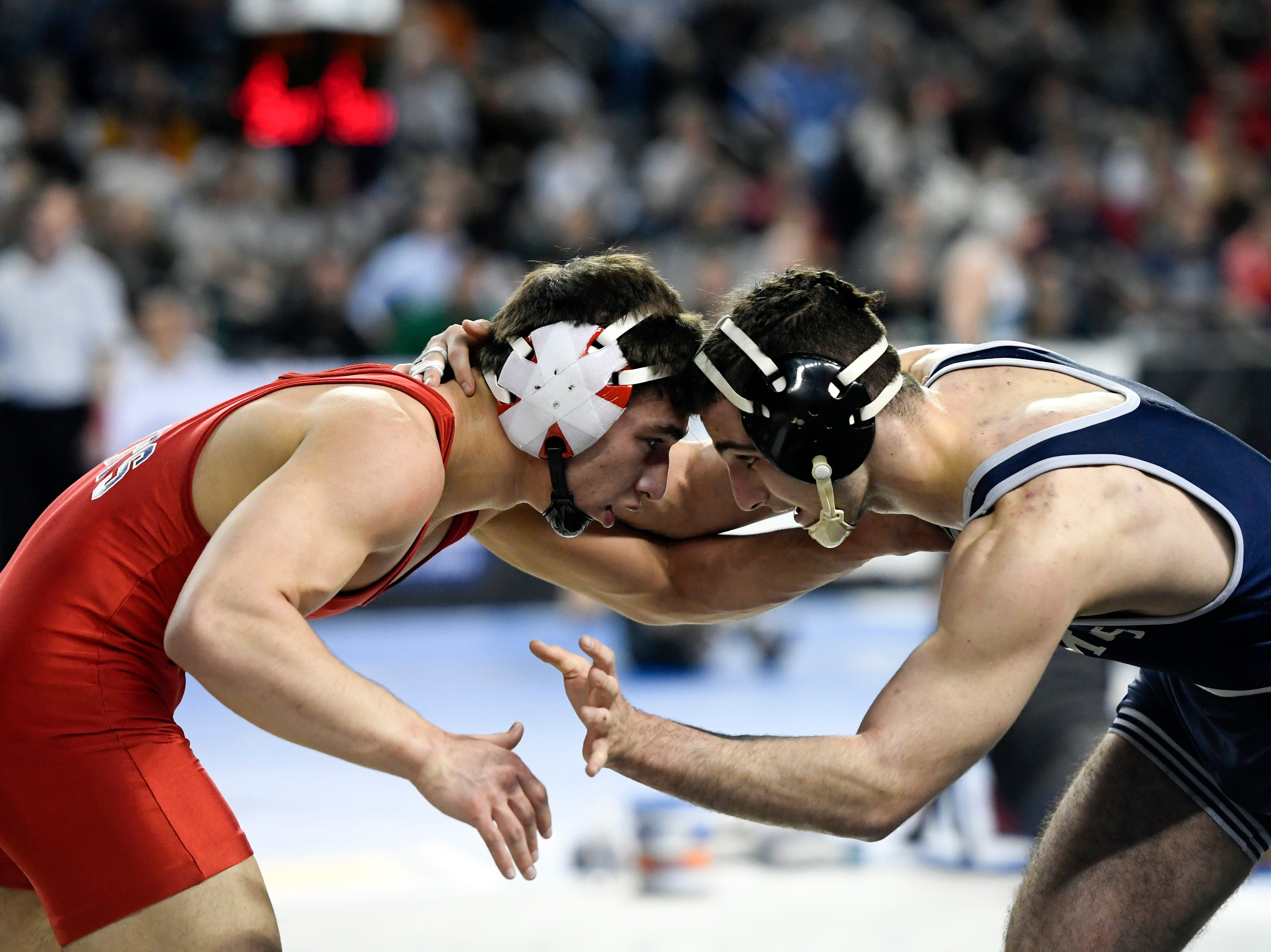 Robert Kanniard of Wall, left, and Tony Asatrian of Paramus wrestle in a 160-pound bout on Day 2 of the NJSIAA state wrestling tournament on Friday, March 1, 2019, in Atlantic City.