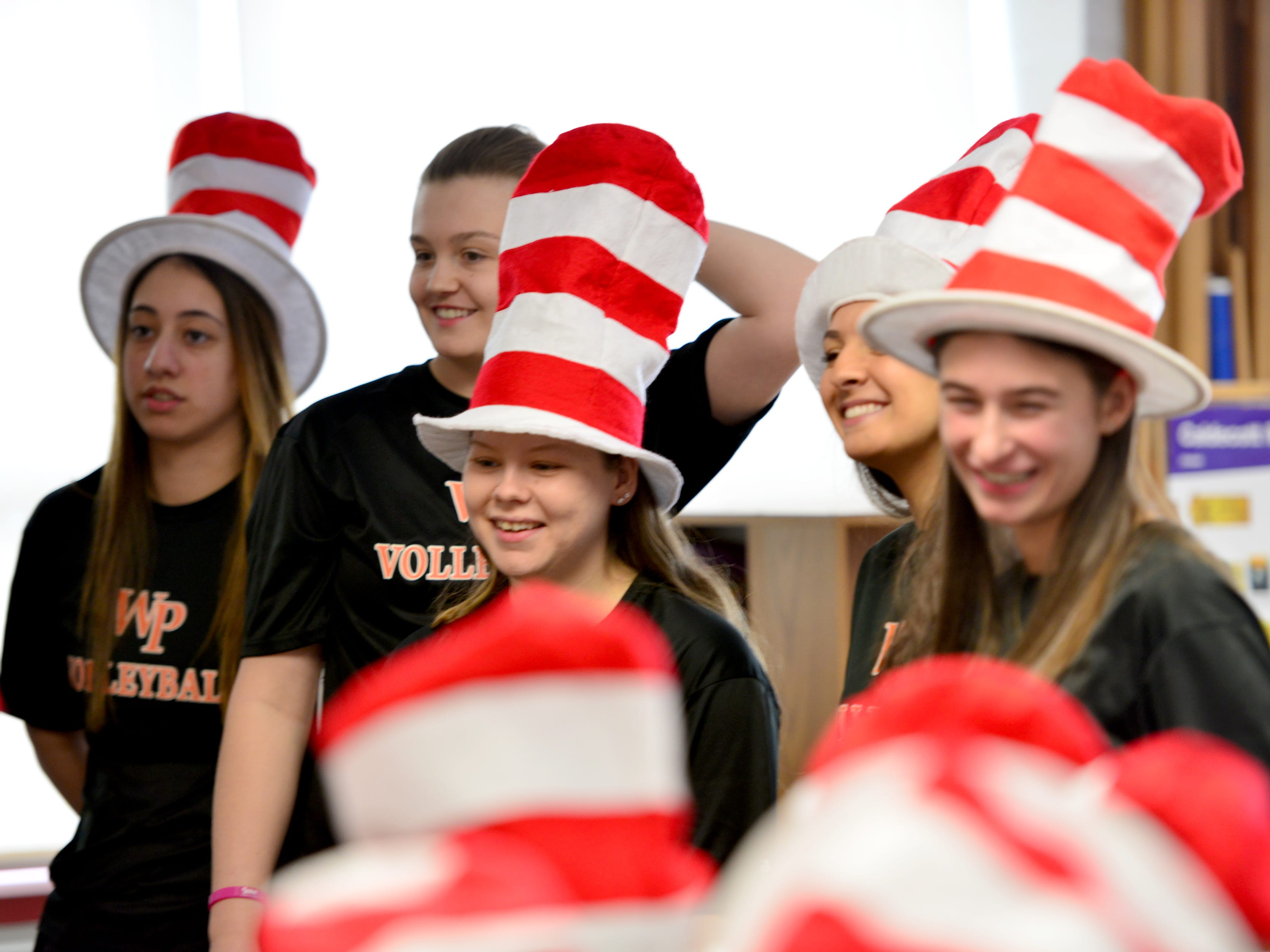 Volleyball players from William Paterson University read to the second grade class at High Mountain Road School in Franklin Lakes on Friday March 1, 2019.