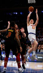 Feb 28, 2019; New York, NY, USA;  New York Knicks forward Henry Ellenson (13) goes to the basket against Cleveland Cavaliers defenders during the first half at Madison Square Garden.