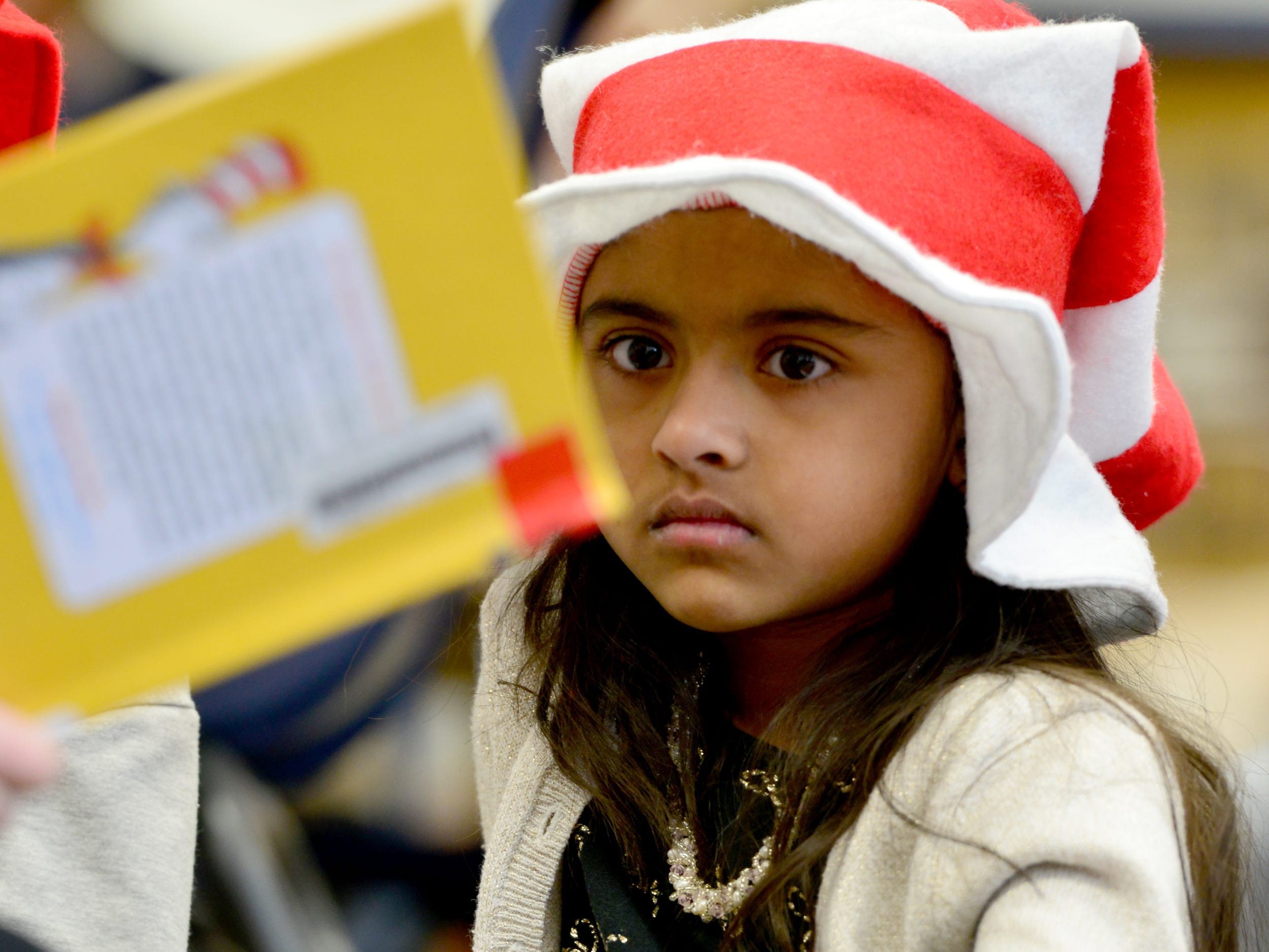 Saanvi Bodami listens to a story. Volleyball players from William Paterson University read to the second grade class at High Mountain Road School in Franklin Lakes on Friday March 1, 2019.