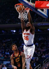 Feb 28, 2019; New York, NY, USA;  New York Knicks center Mitchell Robinson (26) dunks against Cleveland Cavaliers forward Marquese Chriss (3) during the first half at Madison Square Garden.