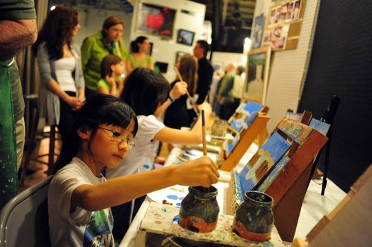 """Vanessa Masri from St. Catherine's school in Ringwood is painting during the children's lessons held during the """"13th Annual: Photo, Art and Poetry Exhibition & Sale,"""" run by the St. Catherine of Bologna Patron of The Arts Association in March 2012."""