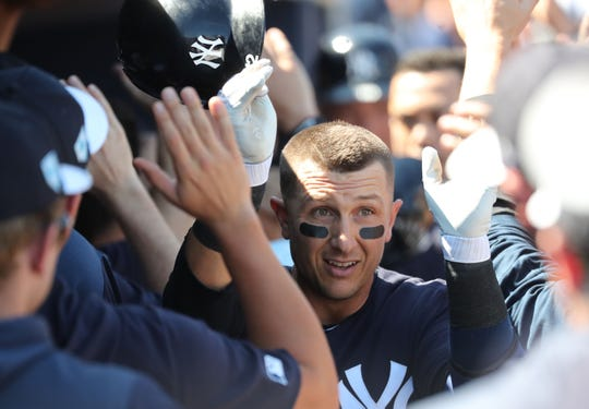Feb 28, 2019; Tampa, FL, USA;New York Yankees shortstop Troy Tulowitzki (12)  is congratulated by teammates as he hits a 3-run home run during the first inning against the Pittsburgh Pirates at George M. Steinbrenner Field.