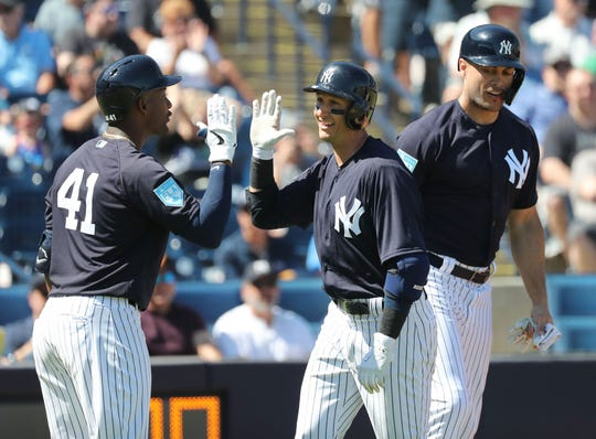 Feb 28, 2019; Tampa, FL, USA;New York Yankees shortstop Troy Tulowitzki (12)  is congratulated by New York Yankees third baseman Miguel Andujar (41) and New York Yankees left fielder Giancarlo Stanton (27) as he hits a 3-run home run during the first inning against the Pittsburgh Pirates at George M. Steinbrenner Field.