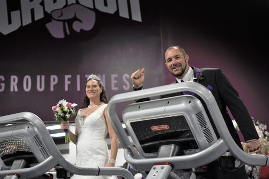 Daniel Butler, 33, right, and Andi Nevue, 36, posed for a light-hearted wedding photo on treadmills at Crunch Fitness in Las Cruces.