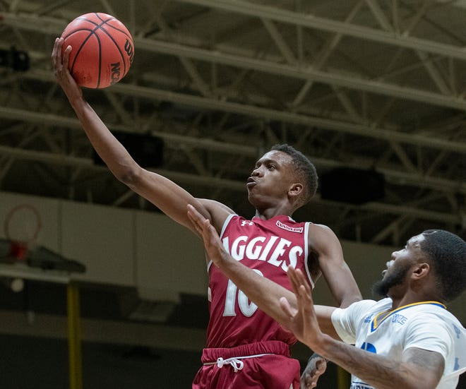 New Mexico State's Jabari Rice glides in for a lay up during Thursday's victory at UMKC.