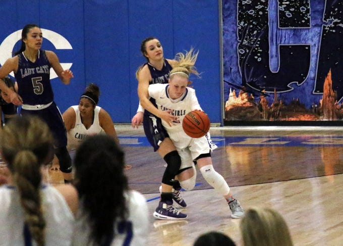 Carlsbad's Carsyn Boswell drives by a Clovis defender during Thursday's Class 4-5A semifinal game.