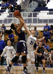 Carlsbad's Morgan Boatwright gets a block during Thursday's Class 4-5A semifinal game.