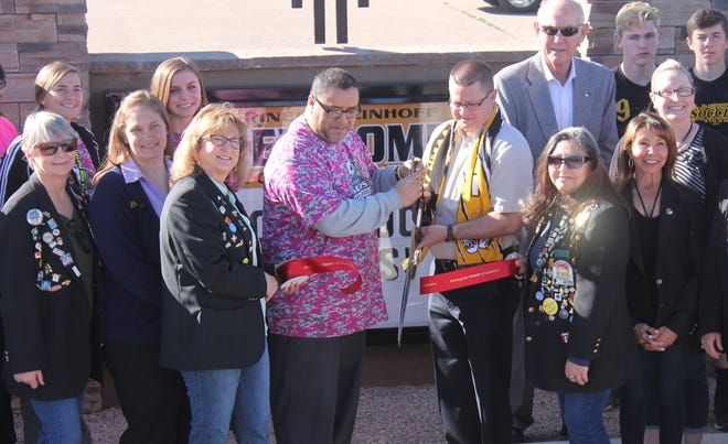 Alamogordo High School Soccer Coaches Rudy Barbosa and Andres Montoya cut the ribbon at the new sign at the Riner Steinhoff Soccer Fields