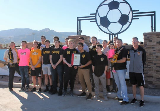 The Alamogordo High School 2018-2019 Boys Soccer Team at the Riner Steinhoff Soccer Fields new sign ribbon cutting.