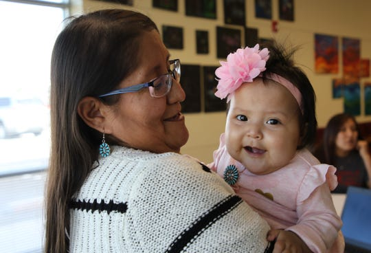 Ora Nez smiles at her daughter, Josephine Nez, during a gathering Friday in Farmington to recognize babies who accompanied their mothers to work at the Navajo Women, Infants and Children Program. Nez is a breastfeeding peer counselor for Navajo WIC's Fort Defiance Program.