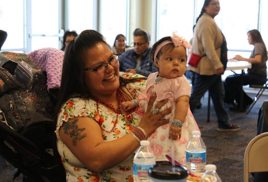 Marnelda Begay holds her daughter, Makayla Jones, at a gathering Friday in Farmington for the Navajo Women, Infants and Children Program. Begay is a breastfeeding peer counselor for the program, which supported Begay in nursing Jones while at work.