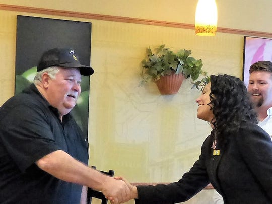 Vietnam Veterans of America chapter service officer Doug Sabo greets U.S. Rep. Xochitl  Torres Small.