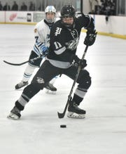 Plymouth Wildcat Jacob Back brings the puck into the Spartan zone.