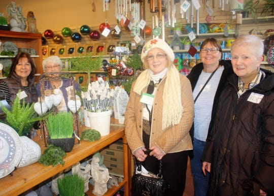 Taking advantage of some of the opening-day sales were (from left) Country Garden Club of Northville members Jackie Wiewiora, Sandy Petroskey, Marcia Mandell, Barb Sturtz and Jo Sillanpaa.