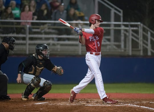 JC Peacher (3) bats during the Catholic vs Pace baseball game at Pace High School on Thursday, February 28, 2019.
