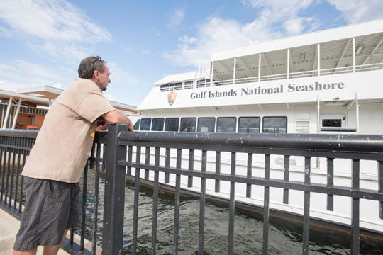 Bruce Alan Martin, of Warrington, checks out the Gulf Island National Seashore ferries that remain idle at the Commendencia Slip Dock in downtown Pensacola on Friday, March 1, 2019.
