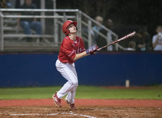 Parker Tubb (2) bats during the Catholic vs Pace baseball game at Pace High School on Thursday, February 28, 2019.