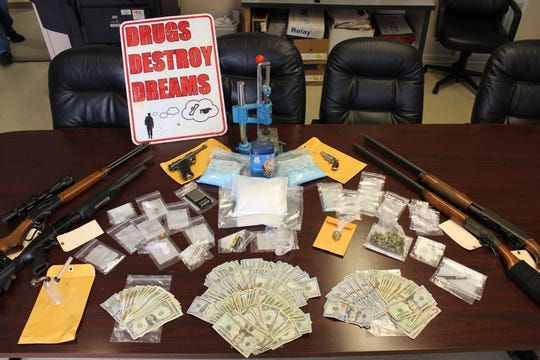 Four people, including a teacher at Jim Allen Elementary School, were arrested Friday and an array of narcotics and guns were seized during the early-morning raid.