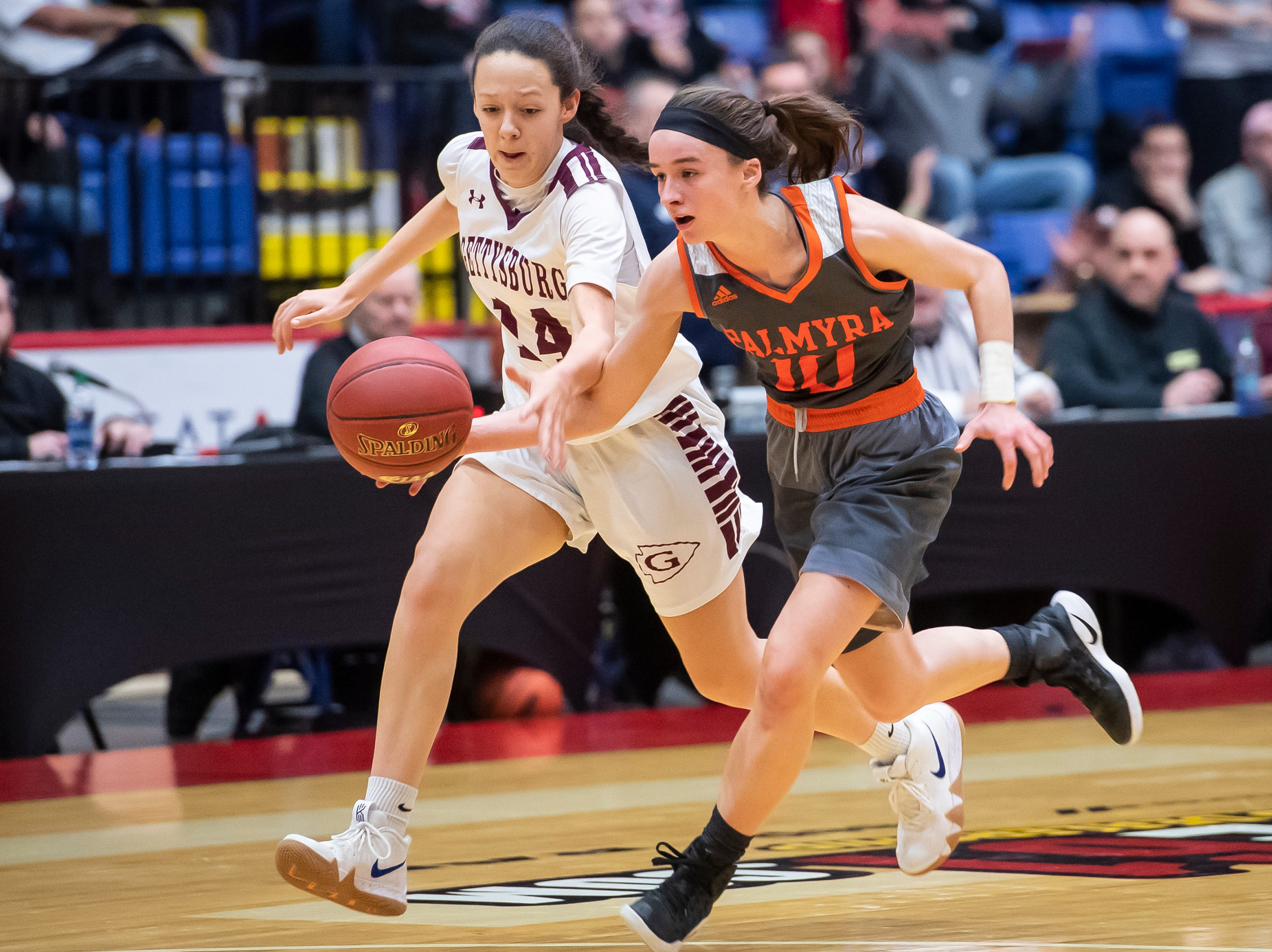 Palmyra's Amelia Baldo chases down the ball with Gettysburg's Madison Proctor during the District 3 5A girls championship game at Santander Arena in Reading, Pa., Friday, March 1, 2019.