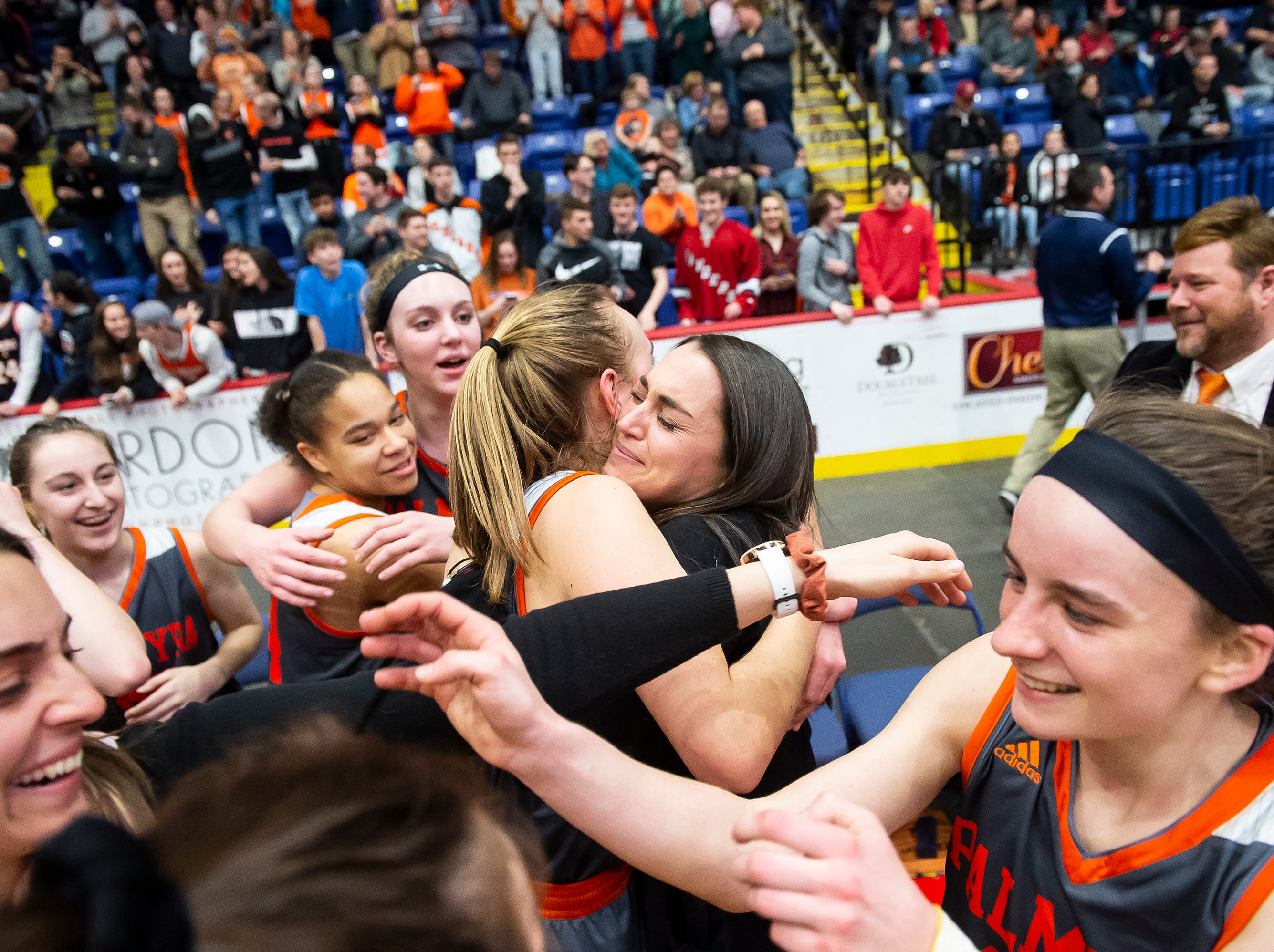 Palmyra players and coaches celebrate after defeating Gettysburg in the District 3 5A girls championship game at Santander Arena in Reading, Pa., Friday, March 1, 2019. The Cougars won 31-23.