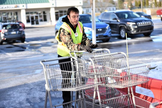 Jeffrey Vogel organizes carts at the Weis Markets in south Hanover on Feb. 21, 2019.
