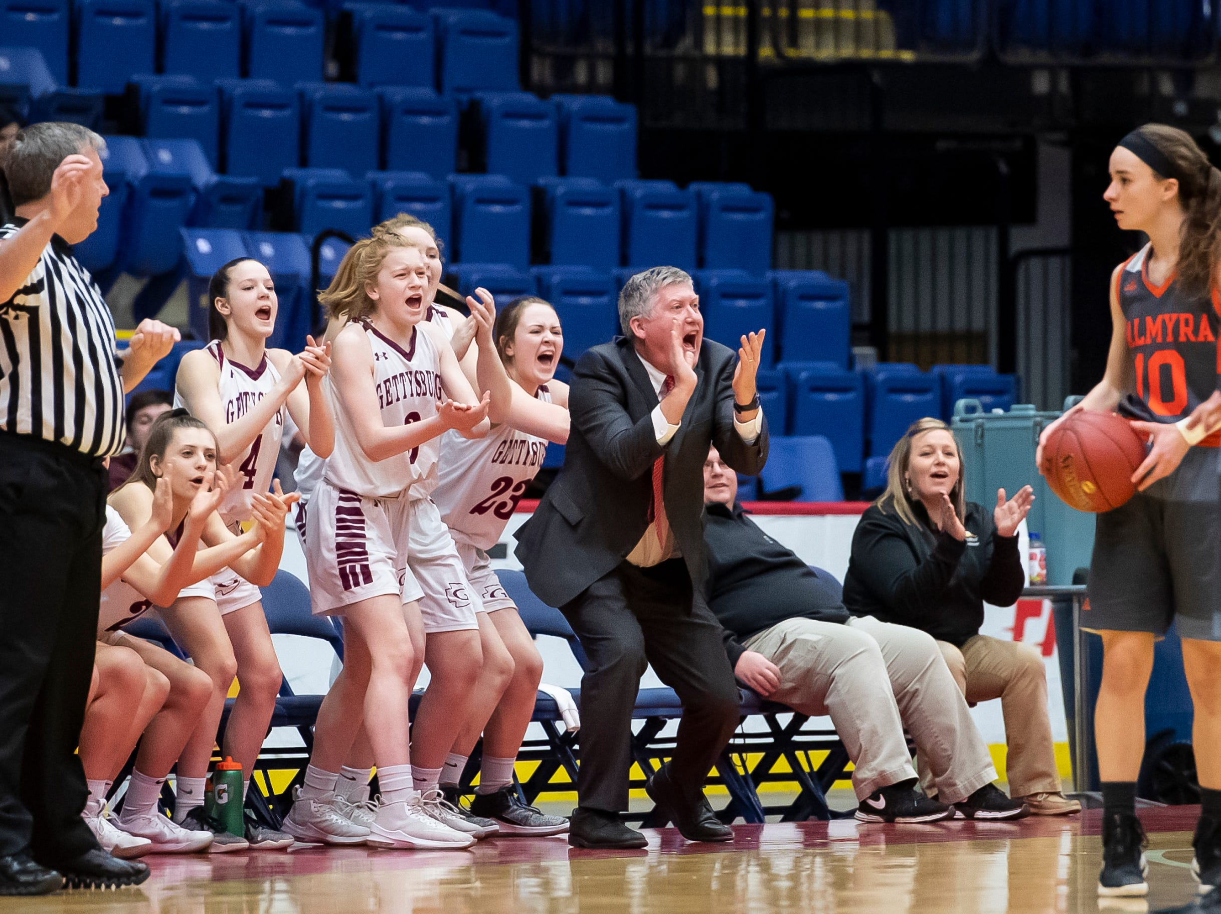 Gettysburg head coach Jeff Bair and the Warriors bench react after forcing a turnover during the District 3 5A girls championship game against Palmyra at Santander Arena in Reading, Pa., Friday, March 1, 2019.