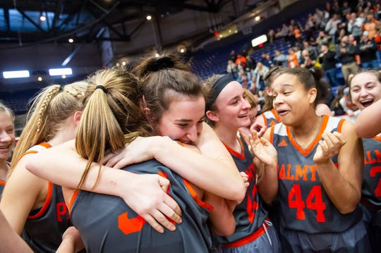 Palmyra players celebrate after defeating Gettysburg in the District 3 5A girls championship game at Santander Arena in Reading, Pa., Friday, March 1, 2019. The Cougars won 31-23.