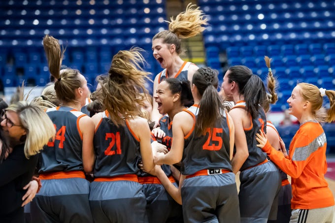 Palmyra celebrates after winning the District 3 5A girls championship game against Gettysburg at Santander Arena in Reading, Pa., Friday, March 1, 2019. Palmyra won 31-23.