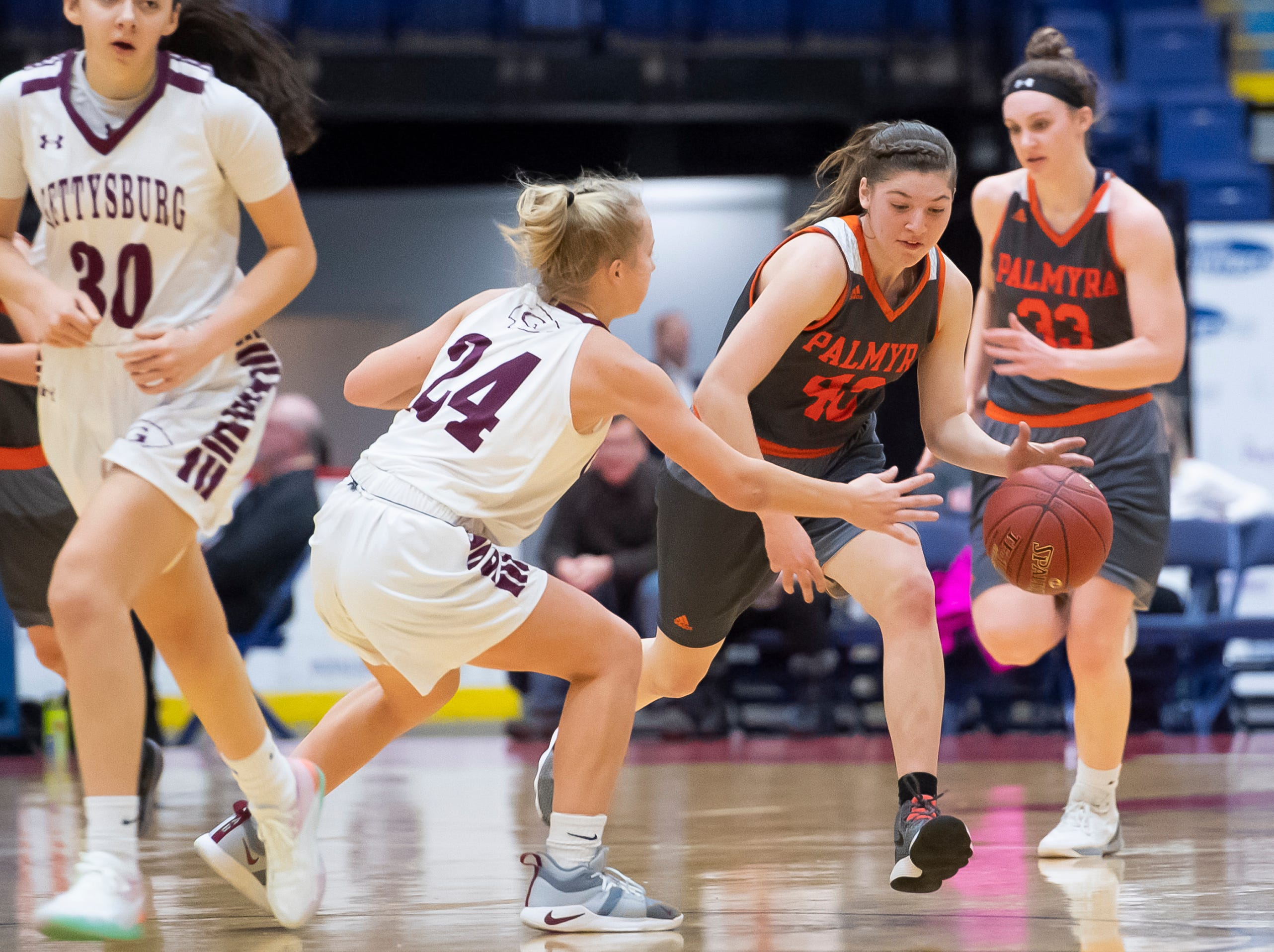Palmyra's Katelyn Becker dribbles down the court against Gettysburg's Anne Bair during the District 3 5A girls championship game at Santander Arena in Reading, Pa., Friday, March 1, 2019.