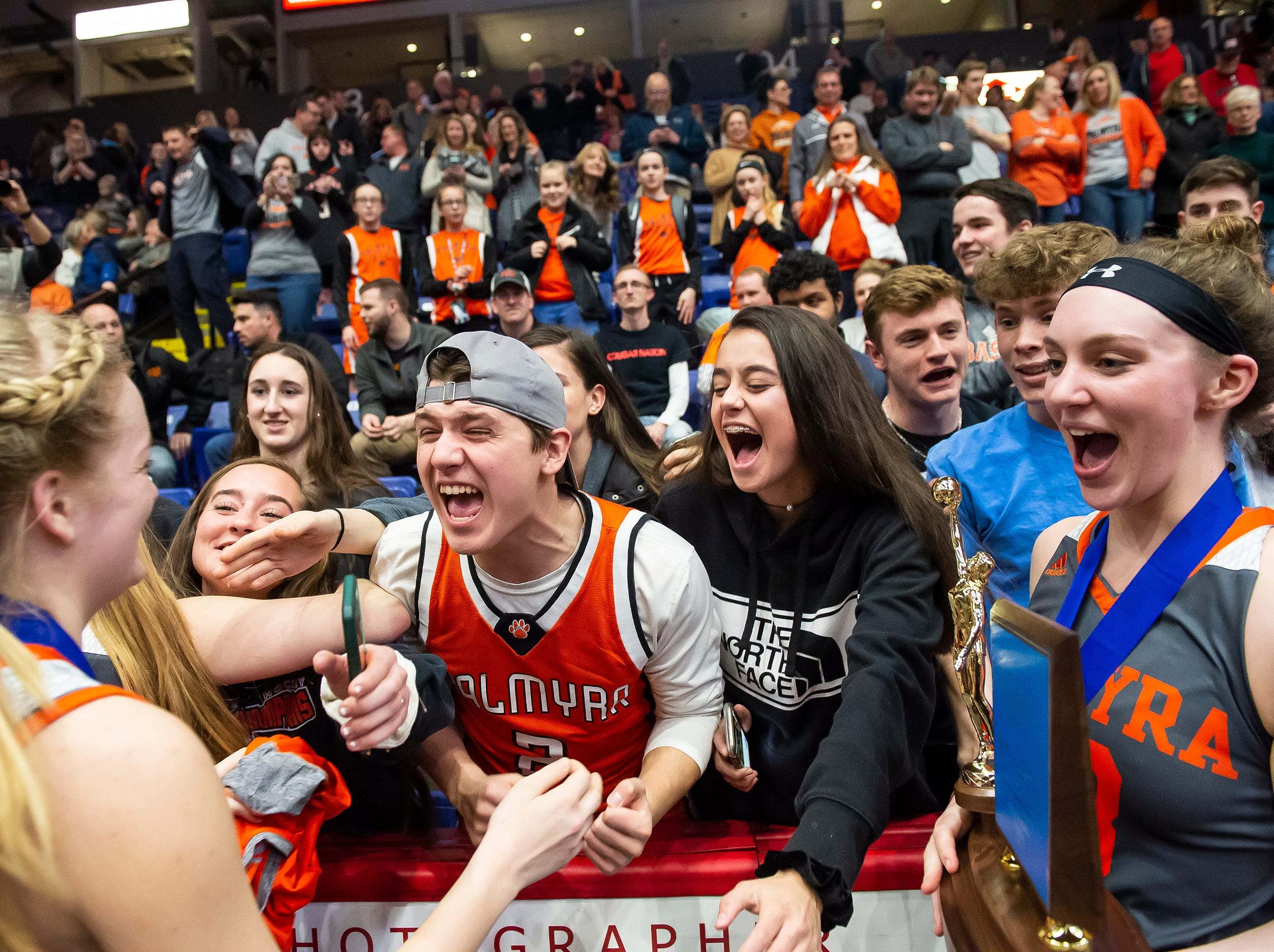 Palmyra players celebrate with the student section after defeating Gettysburg in the District 3 5A girls championship game at Santander Arena in Reading, Pa., Friday, March 1, 2019. The Cougars won 31-23.