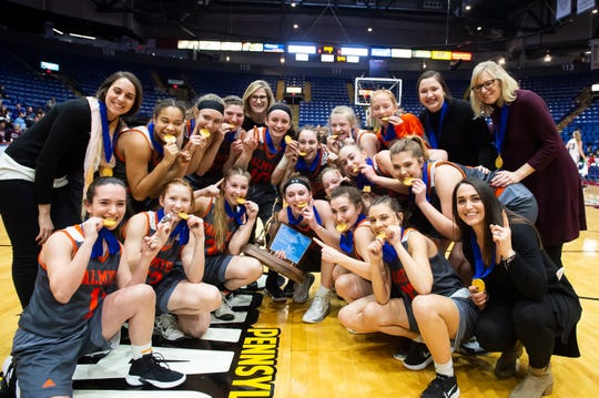 The Palmyra Cougars pose for a photo after defeating Gettysburg in the District 3 5A girls championship game at Santander Arena in Reading, Pa., Friday, March 1, 2019. The Cougars won 31-23.