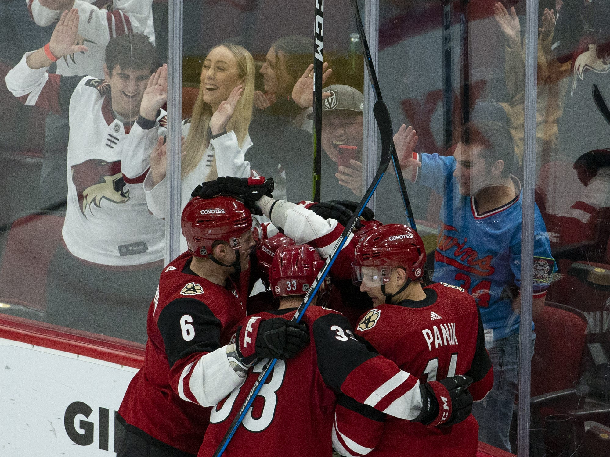 Arizona Coyotes celebrate a second goal by center Brad Richardson (15) during a NHL game against the Vancouver Canucks at Gila River Arena in Glendale on February 28.