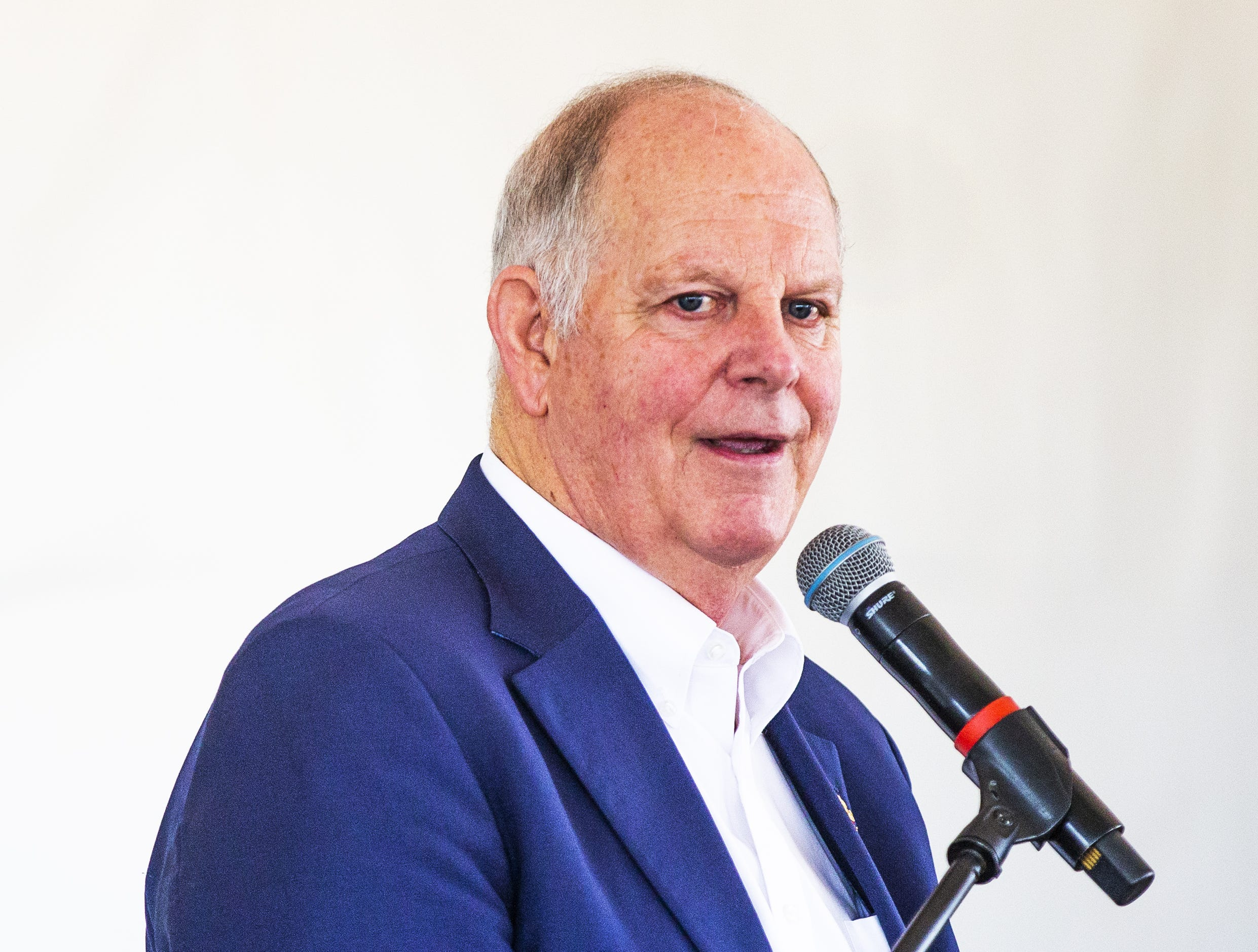 Rep. Tom O'Halleran makes comments to the crowd at the grand opening ceremony for the MAR 5 Interpretive Trail near Sacaton, Friday, March 1, 2019.