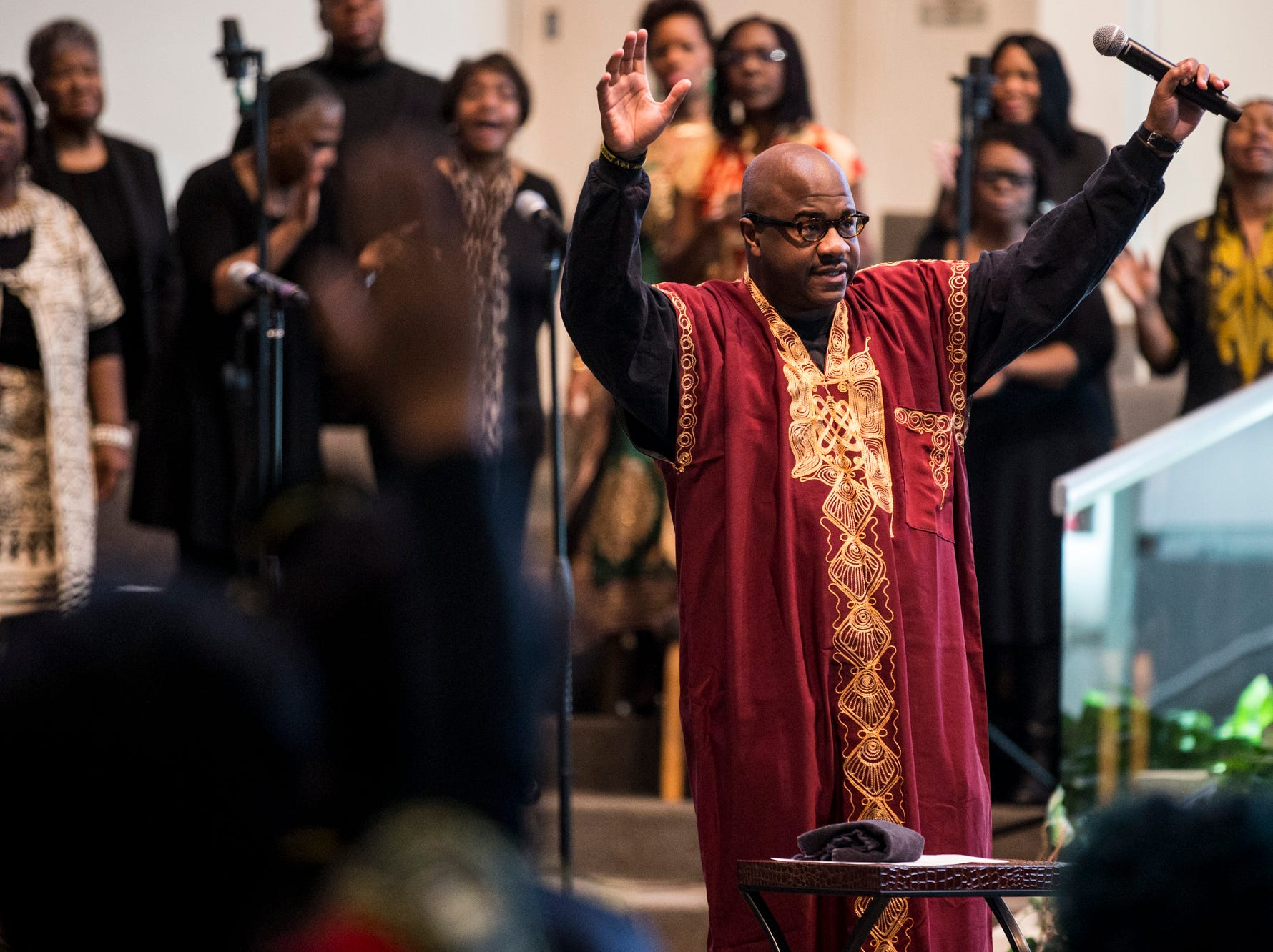 Pastor Terry Mackey raises his arms during the 7:30 a.m. service on Feb. 24, 2019, at Pilgrim Rest Baptist Church in Phoenix. Mackey was appointed to replace the late Bishop Alexis Thomas.