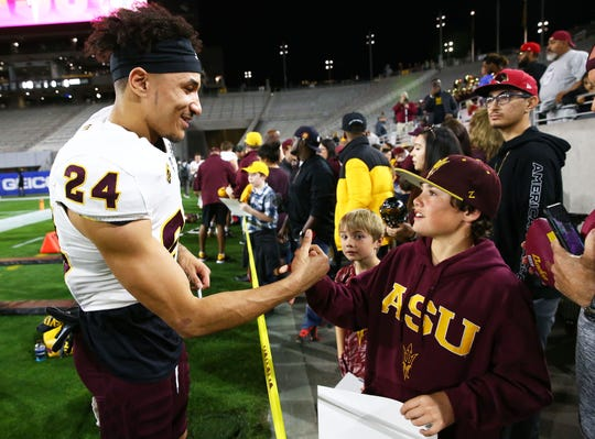 Arizona State defensive back Chase Lucas (24) greets the fans during the spring practice game on Feb. 28, 2019 at Sun Devil Stadium in Tempe, Ariz.