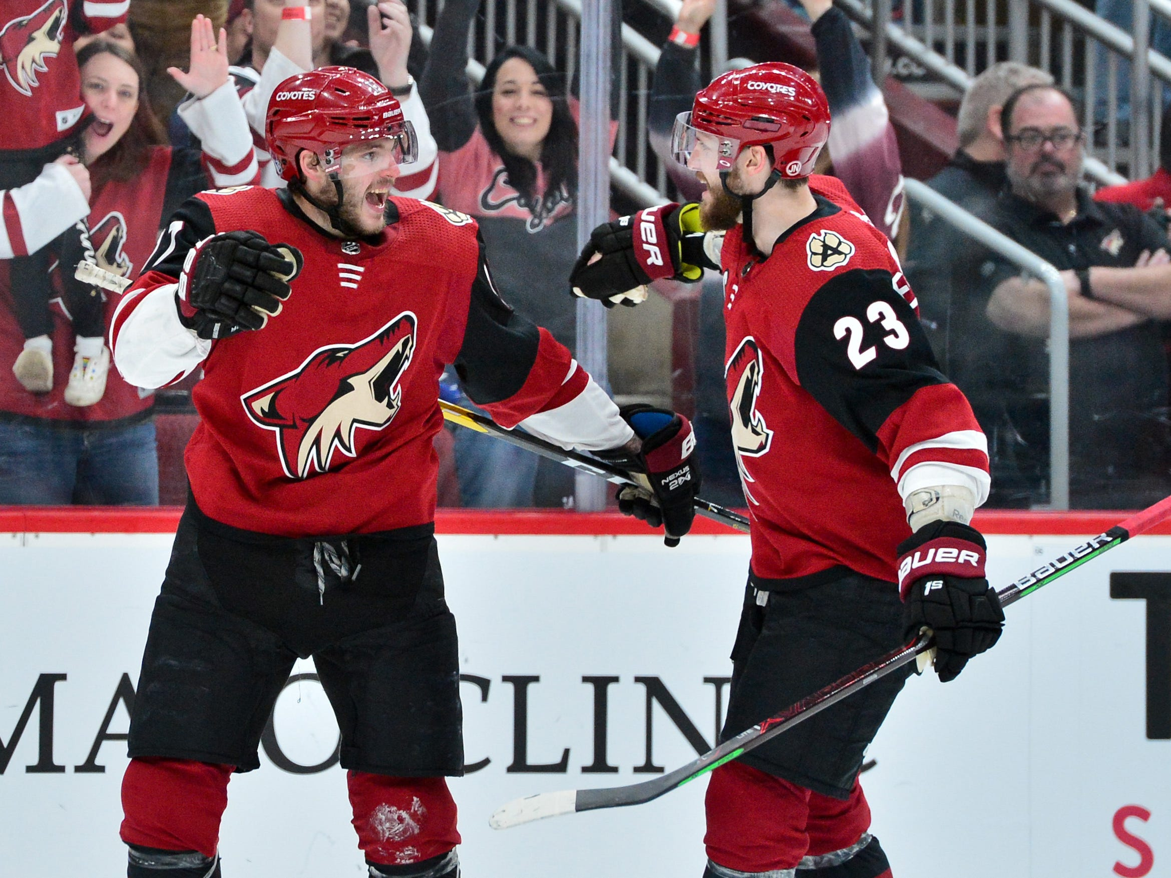 Feb 28, 2019; Glendale, AZ, USA; Arizona Coyotes center Alex Galchenyuk (17) celebrates with defenseman Oliver Ekman-Larsson (23) after scoring a power play goal in the second period against the Vancouver Canucks at Gila River Arena.