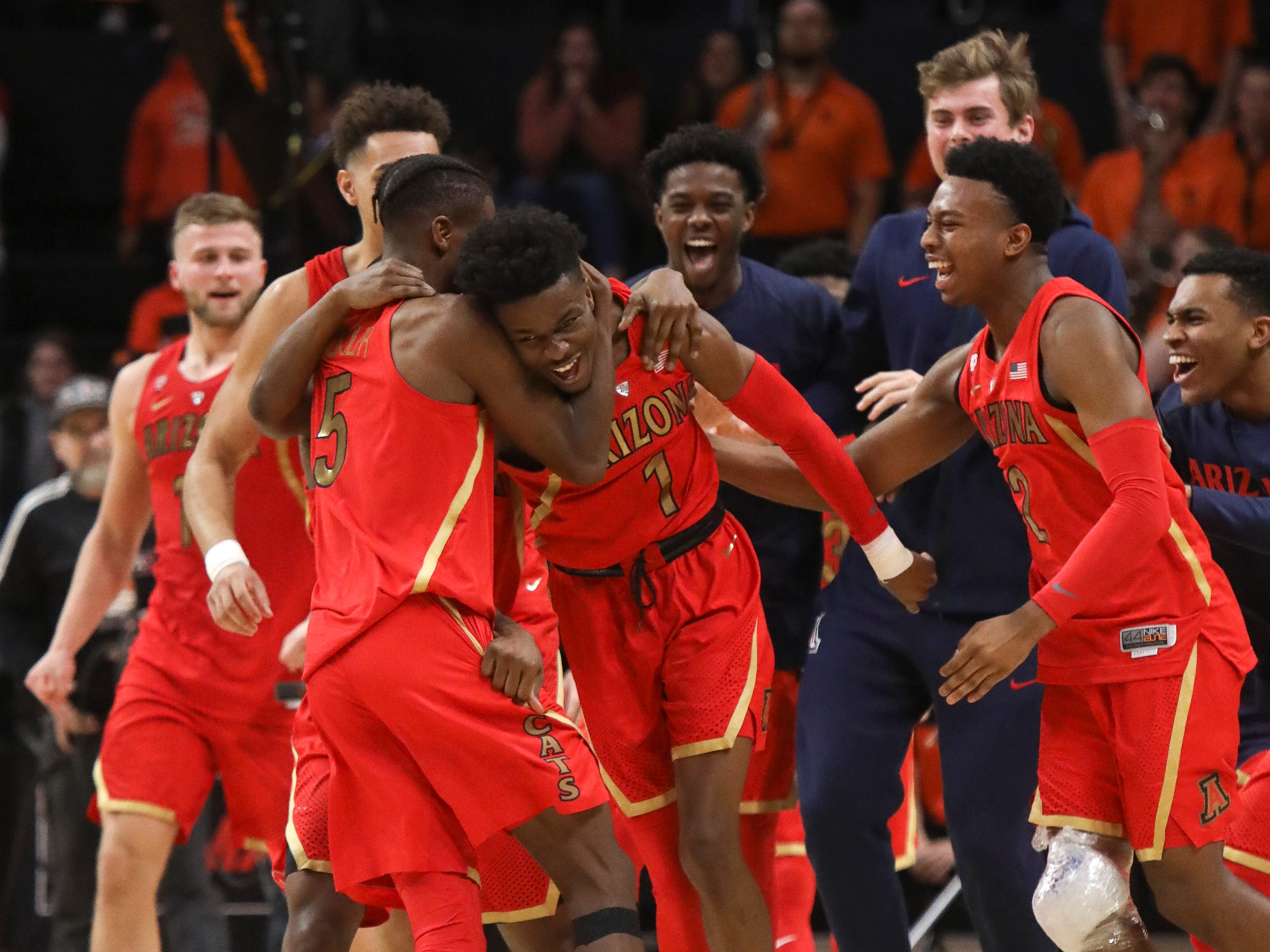 Arizona's Brandon Randolph, left, and Brandon Williams, right, celebrate with Devonaire Doutrive, center, after Doutrive scored in the final second of the game, securing the win over Oregon State during an NCAA college basketball game in Corvallis, Ore., Thursday, Feb. 28, 2019. Arizona won 74-72.
